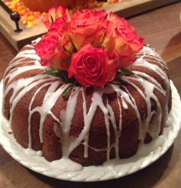 Dessert Centerpiece #1. Bundt Cake with bouquet of flowers in the center.