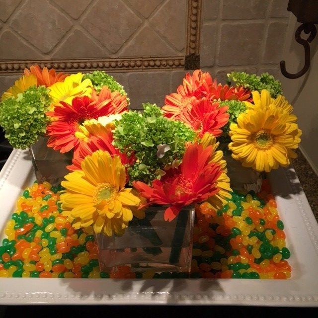 Spring Floral Centerpiece with candy around base.